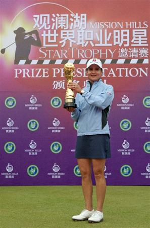 HAIKOU, CHINA - OCTOBER 31:  Lorena Ochoa of Mexico poses with the Mission Hills Start Trophy after winning the tournament during day five of the Mission Hills Start Trophy tournament at Mission Hills Resort on October 31, 2010 in Haikou, China. The Mission Hills Star Trophy is Asia's leading leisure liflestyle event which features Hollywood celebrities and international golf stars.  (Photo by Athit Perawongmetha/Getty Images for Mission Hills)