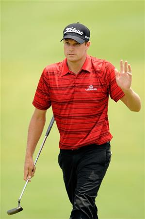 PONTE VEDRA BEACH, FL - MAY 07:  Nick Watney waves to the gallery on the 18th green during the first round of THE PLAYERS Championship on THE PLAYERS Stadium Course at TPC Sawgrass on May 7, 2009 in Ponte Vedra Beach, Florida.  (Photo by Sam Greenwood/Getty Images)