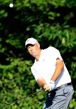 NORTON, MA - SEPTEMBER 04:  Stewart Cink hits a shot on the fifth hole during the second round of the Deutsche Bank Championship at TPC Boston on September 4, 2010 in Norton, Massachusetts.  (Photo by Michael Cohen/Getty Images)