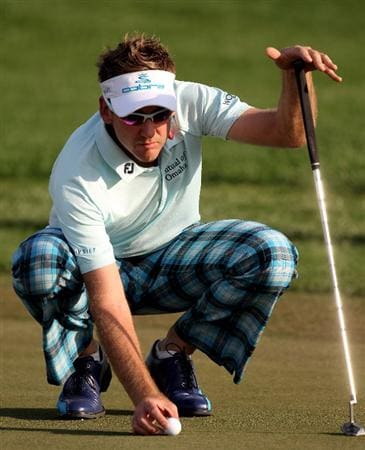 ABU DHABI, UNITED ARAB EMIRATES - JANUARY 21:  Ian Poulter of England on the 16th green during the first round of the Abu Dhabi Golf Championship at Abu Dhabi Golf Club on January 21, 2010 in Abu Dhabi, United Arab Emirates.  (Photo by Ross Kinnaird/Getty Images)
