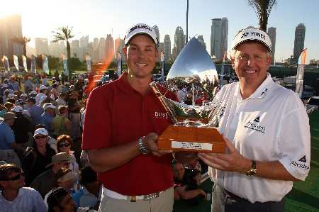 DUBAI, UNITED ARAB EMIRATES - JANUARY 29: Colin Montgomerie of Scotland with his partner Henrik Stenson of Sweden after they had won the Dubai Desert Classic Challenge Match, on January 29, 2007 in Dubai, United Arab Emirates.  (Photo by David Cannon/Getty Images)