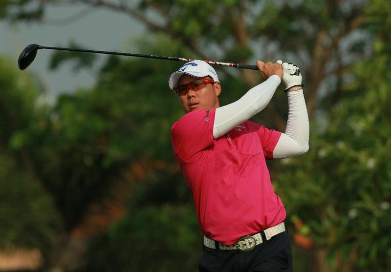 CHON BURI, THAILAND - FEBRUARY 25:  Lam Chih Bing of Singapore watches his tee shot on the 1st hole during day two of The Open Championship Asia Final Qualifying tournament at Amata Spring Country Club on February 25, 2011 in Chon Buri, Thailand.  (Photo by Stanley Chou/Getty Images)