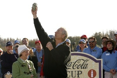 Bill Murray (right) waves a wad of cash in the air before presenting all of it to Jan Horn, executive director and founder of the Blooming Place for Kids, (left) after the final round of the 2007 Outback Steakhouse Pro-Am Sunday, February 18, 2007, at the TPC of Tampa bay in Tampa, Florida. Champions Tour - 2007 Outback Steakhouse Pro-Am - Final RoundPhoto by Kevin C.  Cox/WireImage.com
