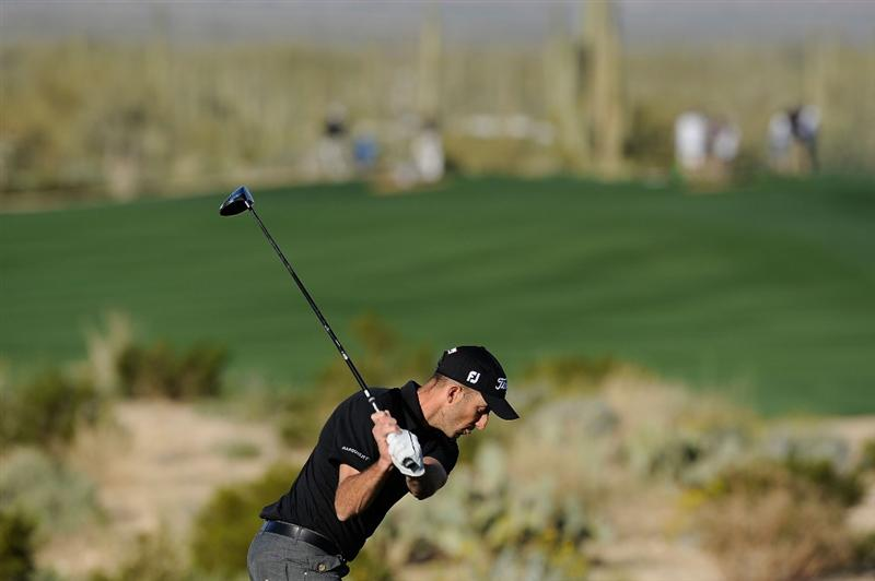 MARANA, AZ - FEBRUARY 17:  Geoff Ogilvy of Australia plays a shot on the second hole during round one of the Accenture Match Play Championship at the Ritz-Carlton Golf Club on February 17, 2010 in Marana, Arizona.  (Photo by Hunter Martin/Getty Images)