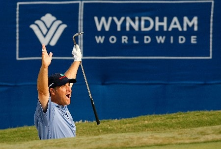 GREENSBORO, NC - AUGUST 16:  Scott McCarron reacts after holing out for a birdie from a bunker around the 18th green during the third round of the 2008 Wyndham Championship at Sedgefield Country Club on August 16, 2008 in Greensboro, North Carolina.  (Photo by Kevin C. Cox/Getty Images)