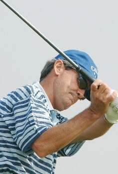 Mark  McNulty checks his grip  before  the final  round of the 2005 Blue Angels Classic  May 15 in Milton, Fl.Photo by Al Messerschmidt/WireImage.com
