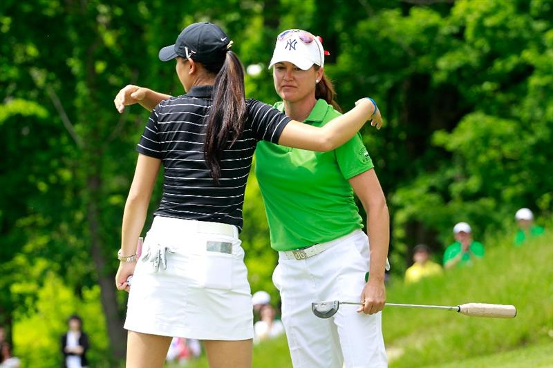 GLADSTONE, NJ - MAY 21:  Michelle Wie (L) hugs Sophie Gustafson (R) of Sweden on the 18th green following her loss to Gustafson in round three of the Sybase Match Play Championship at Hamilton Farm Golf Club on May 21, 2011 in Gladstone, New Jersey.  (Photo by Chris Trotman/Getty Images)