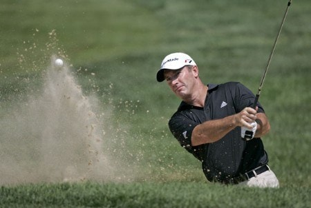 Peter Lonard of Australia hits out of a bunker on the 14th hole during the first round of the NEC Invitational at Firestone Country Club in Akron, Ohio on August 18, 2005.Photo by Sam Greenwood/WireImage.com