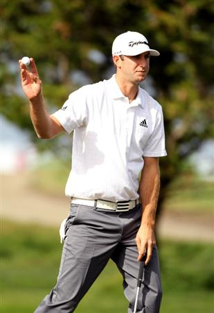 PEBBLE BEACH, CA - FEBRUARY 12:  Dustin Johnson waves to the crowd after making a putt on the 16th hole during round two of the AT&T Pebble Beach National Pro-Am at Monterey Peninsula Country Club Shore Course on February 12, 2010 in Pebble Beach, California.  (Photo by Ezra Shaw/Getty Images)