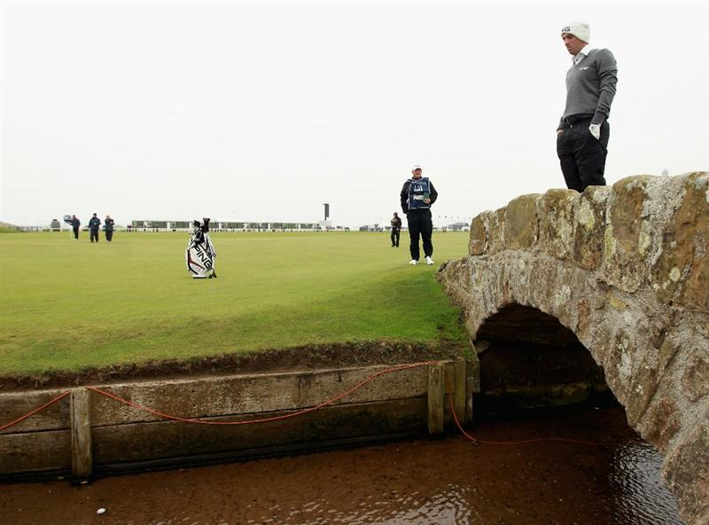 ST ANDREWS, SCOTLAND - OCTOBER 10:  John Parry of England looks at his ball after driving into the burn of the first hole during the final round of The Alfred Dunhill Links Championship at The Old Course on October 10, 2010 in St Andrews, Scotland.  (Photo by Warren Little/Getty Images).