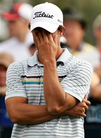MELBOURNE, AUSTRALIA - NOVEMBER 13:  Adam Scott of Australia covers his face with his hand before teeing off on the 14th hole during round two of the 2009 Australian Masters at Kingston Heath Golf Club on November 13, 2009 in Melbourne, Australia.  (Photo by Mark Dadswell/Getty Images)