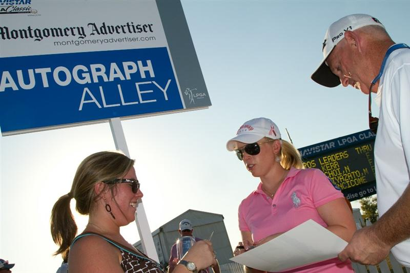 PRATTVILLE, AL - OCTOBER 8: Morgan Pressel signs autographs following  the second round of the Navistar LPGA Classic at the Senator Course at the Robert Trent Jones Golf Trail  on October 8, 2010 in Prattville, Alabama. (Photo by Darren Carroll/Getty Images)