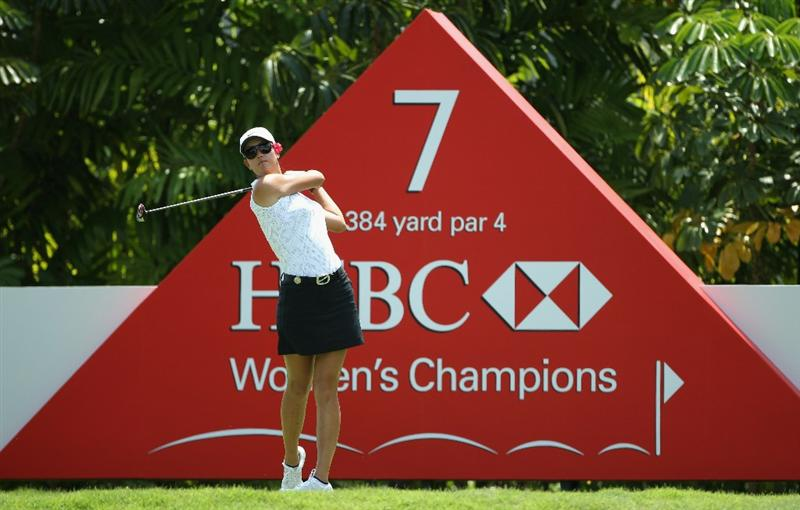 SINGAPORE - FEBRUARY 24:  Michelle Wie of the USA hits her tee-shot on the seventh hole during the first round of the HSBC Women's Champions at the Tanah Merah Country Club on February 24, 2011 in Singapore.  (Photo by Andrew Redington/Getty Images)