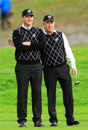 NEWPORT, WALES - OCTOBER 03:  Peter Hanson of Europe is embraced by Miguel Angel Jimenez (R) on the 16th hole during the  Fourball & Foursome Matches during the 2010 Ryder Cup at the Celtic Manor Resort on October 3, 2010 in Newport, Wales.  (Photo by David Cannon/Getty Images)