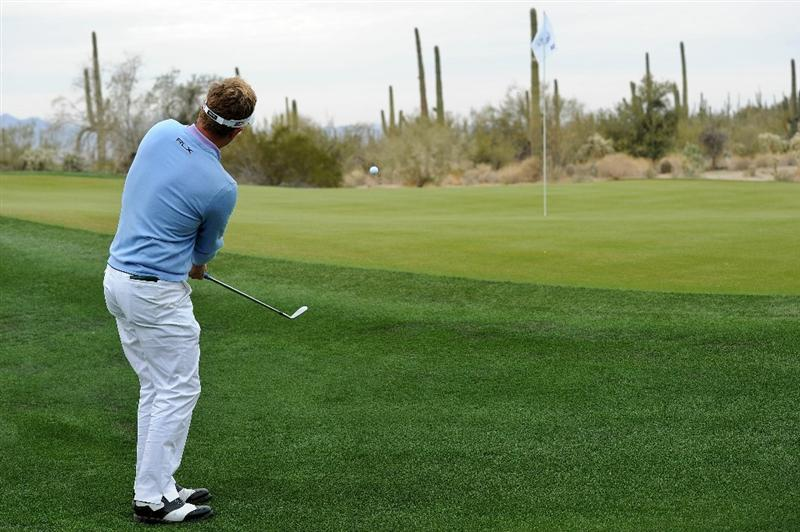 MARANA, AZ - FEBRUARY 26:  Luke Donald of England hits his second shot on the 12th hole during the semifinal round of the Accenture Match Play Championship at the Ritz-Carlton Golf Club on February 26, 2011 in Marana, Arizona.  (Photo by Stuart Franklin/Getty Images)