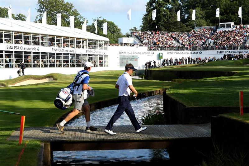 VIRGINIA WATER, ENGLAND - MAY 29:  Luke Donald of England walks with his caddie John McLaren up the 18th hole during the final round of the BMW PGA Championship  at the Wentworth Club on May 29, 2011 in Virginia Water, England.  (Photo by Warren Little/Getty Images)