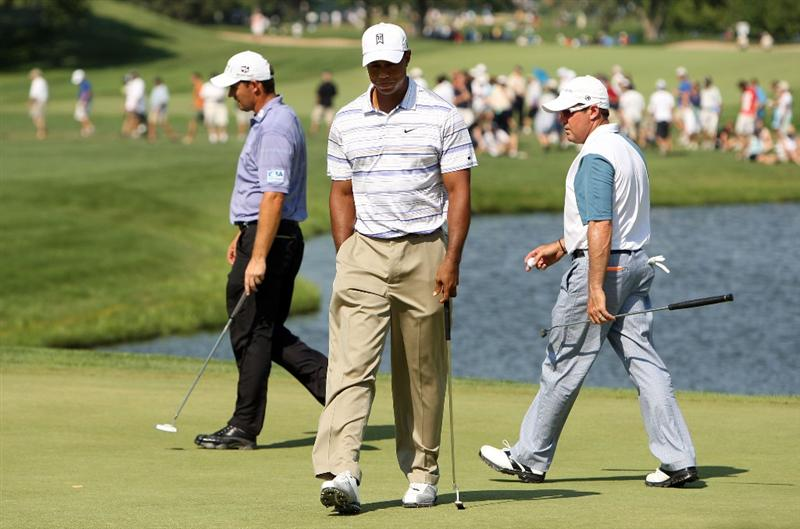 CHASKA, MN - AUGUST 14:  (L-R) Padraig Harrington of Ireland, Tiger Woods and Rich Beem walk across the eighth green during the second round of the 91st PGA Championship at Hazeltine National Golf Club on August 14, 2009 in Chaska, Minnesota.  (Photo by Streeter Lecka/Getty Images)