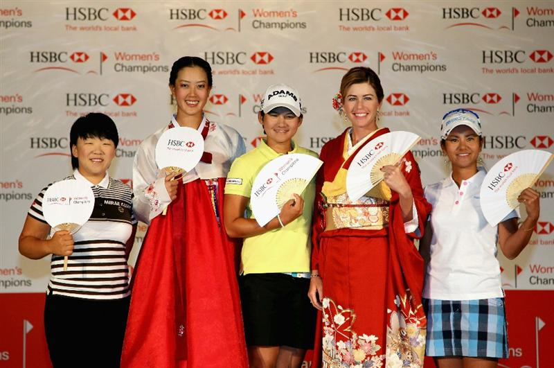 SINGAPORE - FEBRUARY 22:  (L-R) Jiyai Shin of South Korea; Michelle Wie of the USA; Yani Tseng of Taiwan; Paula Creamer of the USA; Ai Miyazato of Japan pose for pictures during a photocall at the Fairmont Hotel prior to the start of the HSBC Women's Champions at the Tanah Merah Country Club on February 22, 2011 in Singapore.  (Photo by Andrew Redington/Getty Images)