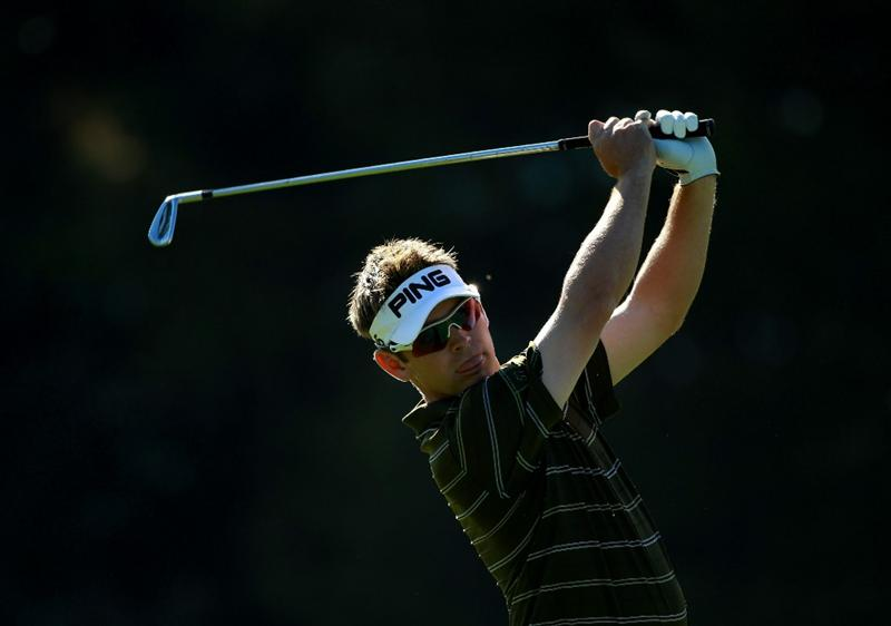 CRANS, SWITZERLAND - SEPTEMBER 03:  Louis Oosthuizen of South Africa plays his second shot into the 15th green during the second round of The Omega European Masters at Crans-Sur-Sierre Golf Club on September 3, 2010 in Crans Montana, Switzerland.  (Photo by Warren Little/Getty Images)