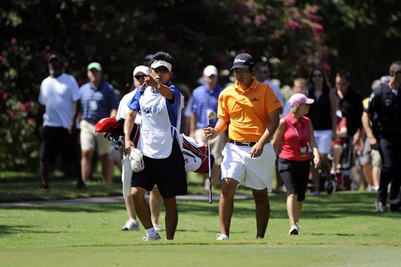 TULSA, OK - AUGUST 30:  Byeong-Hun An walks up the 6th hole fairway with his father, Jae An who served as his caddie during the Finals of the U.S. Amateur Golf Championship on August 30, 2009 at Southern Hills Country Club in Tulsa, Oklahoma.  (Photo by G. Newman Lowrance/Getty Images)