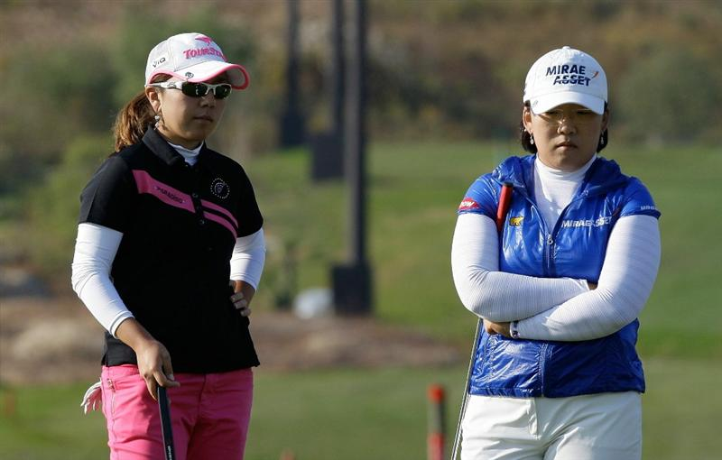INCHEON, SOUTH KOREA - OCTOBER 31:  (L to ) Mika Miyazato of Japan and Shin Ji-Yai of South Korea on the 18th hole during the final round of the 2010 LPGA Hana Bank Championship at Sky 72 Golf Club on October 31, 2010 in Incheon, South Korea.  (Photo by Chung Sung-Jun/Getty Images)