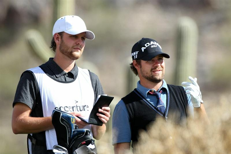 MARANA, AZ - FEBRUARY 25:  Ryan Moore (R) talks with his caddie Jason Moore on the 16th hole during the third round of the Accenture Match Play Championship at the Ritz-Carlton Golf Club on February 25, 2011 in Marana, Arizona.  (Photo by Sam Greenwood/Getty Images)
