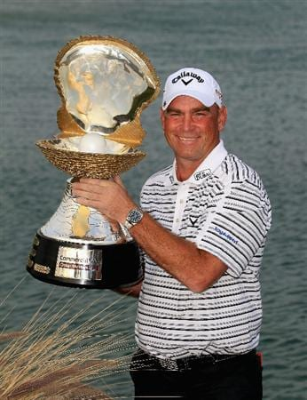 DOHA, QATAR - FEBRUARY 06:  Thomas Bjorn of Denmark poses with the trophy after winning the Commercialbank Qatar Masters held at Doha Golf Club on February 6, 2011 in Doha, Qatar.  (Photo by Andrew Redington/Getty Images)
