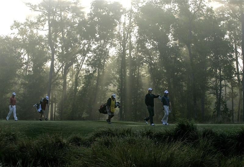 HUMBLE, TX - APRIL 01:  Players walk on the 10th tee box after  fog delays the second round of the Shell Houston Open at Redstone Golf Club on April 1, 2011 in Humble, Texas.  (Photo by Michael Cohen/Getty Images)