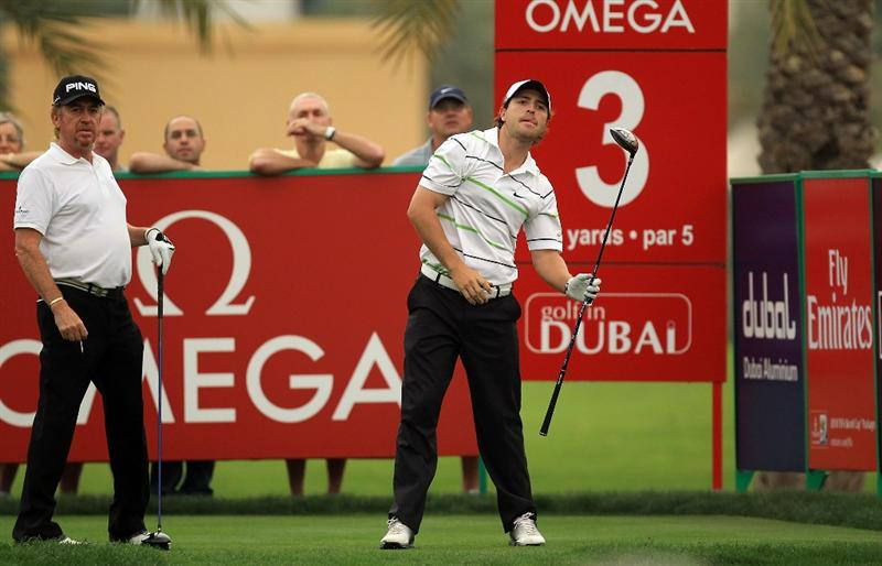 DUBAI, UNITED ARAB EMIRATES - FEBRUARY 05:  Pablo Martin of Spain watches his tee shot at the 3rd hole watched by his playing partner Miguel Angel Jimenez of Spain during the second round of the 2010 Omega Dubai Desert Classic on the Majilis Course at the Emirates Golf Club on February 5, 2010 in Dubai, United Arab Emirates.  (Photo by David Cannon/Getty Images)