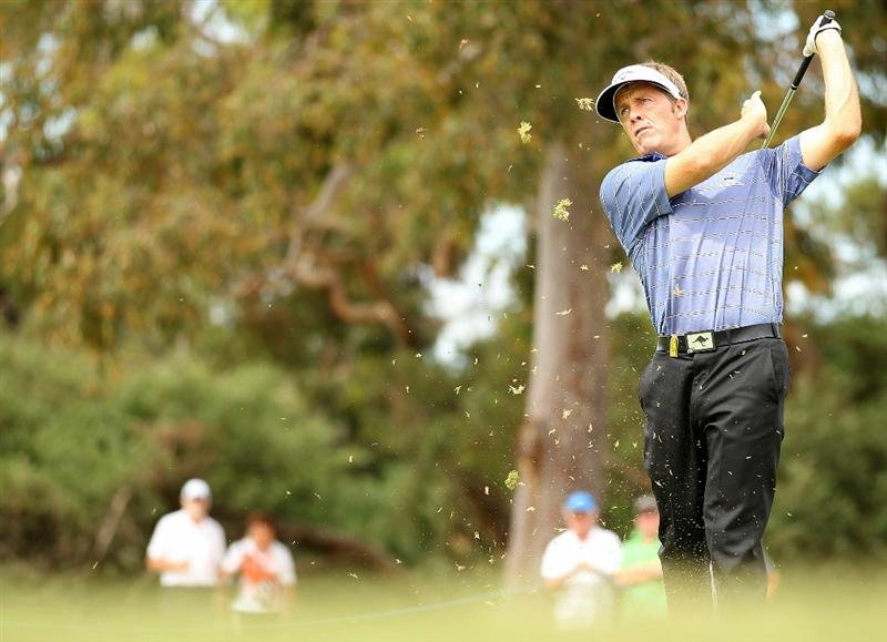 MELBOURNE, AUSTRALIA - NOVEMBER 12:  Stuart Appleby of Australia hits his shot off the fairway during round two of the Australian Masters at The Victoria Golf Club on November 12, 2010 in Melbourne, Australia.  (Photo by Robert Cianflone/Getty Images)