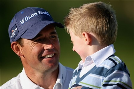 SOUTHPORT, UNITED KINGDOM - JULY 20:  Padraig Harrington celebrates with son Patrick on the 18th green after a 4 stroke victory during the final round of the 137th Open Championship on July 20, 2008 at Royal Birkdale Golf Club, Southport, England.  (Photo by Andy Lyons/Getty Images)