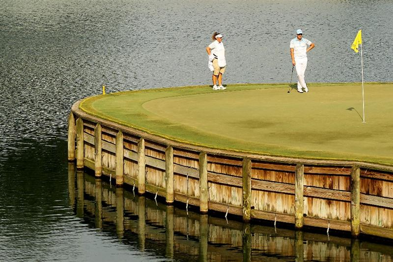 PONTE VEDRA BEACH, FL - MAY 13:  Henrik Stenson of Sweden (R) and caddie Fanny Sunesson (L) look on from the 17th green during the second round of THE PLAYERS Championship held at THE PLAYERS Stadium course at TPC Sawgrass on May 13, 2011 in Ponte Vedra Beach, Florida.  (Photo by Mike Ehrmann/Getty Images)