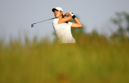 HAVRE DE GRACE, MD - JUNE 07:  Michelle Wie hits her tee shot on the par 3 7th hole during the first round of the McDonalds LPGA Championship at Bulle Rock golf course on June 7, 2007 in Havre de Grace, Maryland.  (Photo by Andy Lyons/Getty Images)