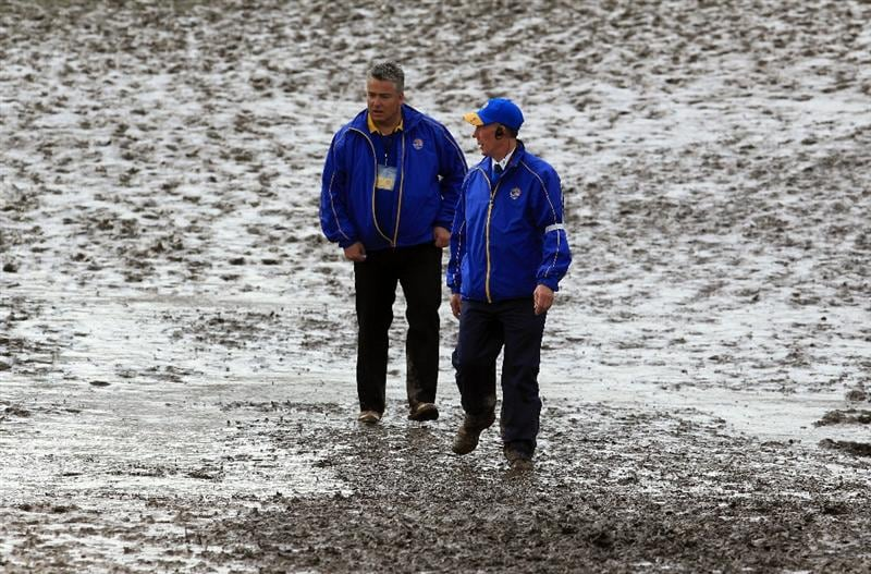 NEWPORT, WALES - OCTOBER 02:  Marshalls walk in the mud during the rescheduled Afternoon Foursome Matches during the 2010 Ryder Cup at the Celtic Manor Resort on October 2, 2010 in Newport, Wales. (Photo by David Cannon/Getty Images)