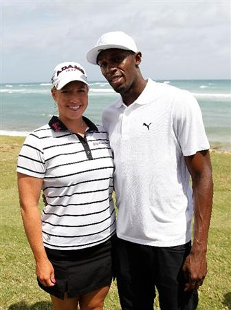 MONTEGO BAY, JAMAICA - APRIL 16:  Usain Bolt and Brittany Lincicome of the United States pose for a photo during the semifinal matches of The Mojo 6 Jamaica LPGA Invitational at Cinnamon Hill Golf Course on April 16, 2010 in Montego Bay, Jamaica.  (Photo by Kevin C. Cox/Getty Images)