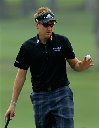 HONG KONG - NOVEMBER 21: Ian Poulter of England reacts on sinking a birdie on the 6th hole during day four of the UBS Hong Kong Open at The Hong Kong Golf Club on November 21, 2010 in Hong Kong, Hong Kong.  (Photo by Stanley Chou/Getty Images)
