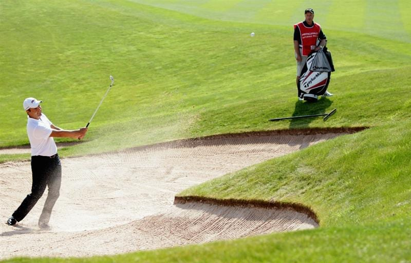 NEWPORT, WALES - JUNE 03:  Simon Khan of England plays a bunker shot on the 16th hole during the first round of the Celtic Manor Wales Open on The Twenty Ten Course at The Celtic Manor Resort on June 3, 2010 in Newport, Wales.  (Photo by Andrew Redington/Getty Images)