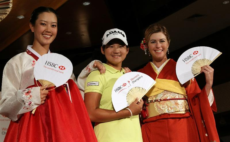 SINGAPORE - FEBRUARY 22:  Michelle Wie of the USA, Yani Tseng of China and Paula Creamer of the USA in traditional Korean and Japanese dress during a photocall at the Fairmont Hotel prior to the HSBC Women's Champions at Tanah Merah Country Club  on February 22, 2011 in Singapore, Singapore.  (Photo by Ross Kinnaird/Getty Images)