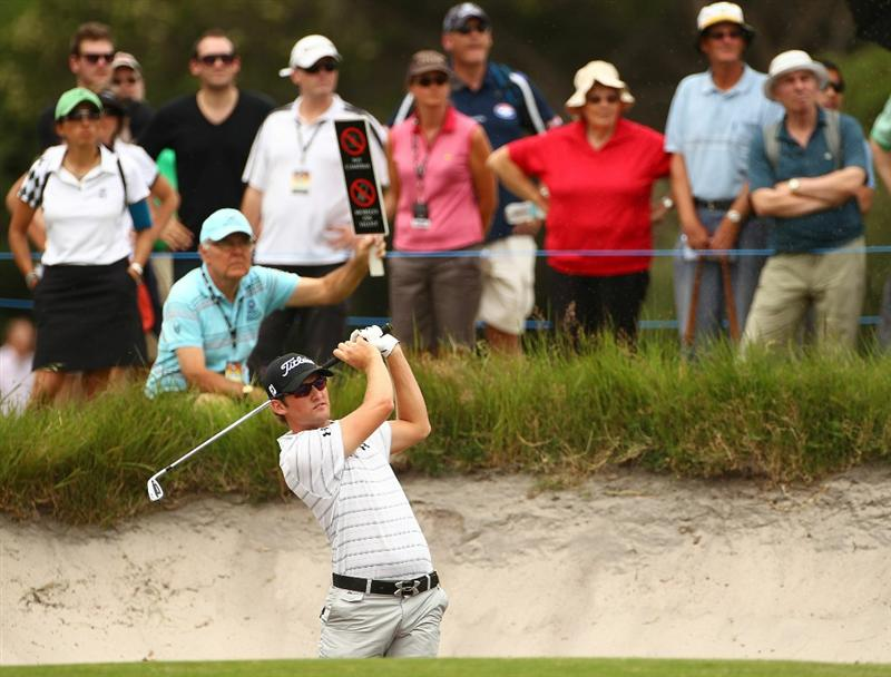 MELBOURNE, AUSTRALIA - NOVEMBER 11:  Michael Sim of Australia hits his shot out of the bunker during day one of the Australian Masters at The Victoria Golf Club on November 11, 2010 in Melbourne, Australia.  (Photo by Robert Cianflone/Getty Images)