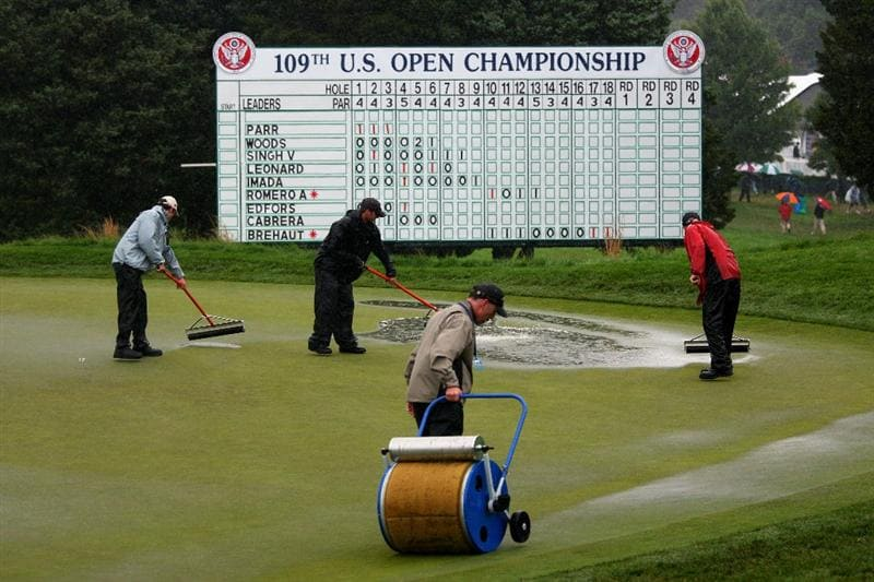 FARMINGDALE, NY - JUNE 18:  Members of the grounds staff work on a soggy 18th green during the first round of the 109th U.S. Open on the Black Course at Bethpage State Park on June 18, 2009 in Farmingdale, New York.  (Photo by Andrew Redington/Getty Images)