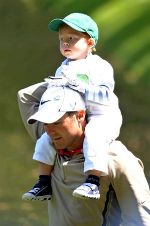 AUGUSTA, GA - APRIL 08:  Trevor Immelman of South Africa walks with his son Jacob during the Par 3 Contest prior to the 2009 Masters Tournament at Augusta National Golf Club on April 8, 2009 in Augusta, Georgia.  (Photo by Harry How/Getty Images)