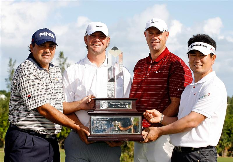 SOUTHAMPTON, BERMUDA - OCTOBER 20:  Angel Cabrera, Lucas Glover, Stewart Cink and Y.E. Yang hold the Grand Slam of Golf trophy before the first round of the PGA Grand Slam of Golf on October 20, 2009 Port Royal Golf Course in Southampton, Bermuda.  (Photo by Andy Lyons/Getty Images)