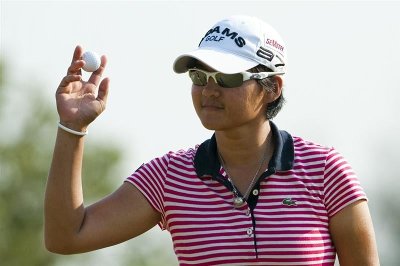 CHON BURI, THAILAND - FEBRUARY 20:  Yani Tseng of Taiwan acknowledges to the crowd on the 17th green during day four of the LPGA Thailand at Siam Country Club on February 20, 2011 in Chon Buri, Thailand.  (Photo by Victor Fraile/Getty Images)