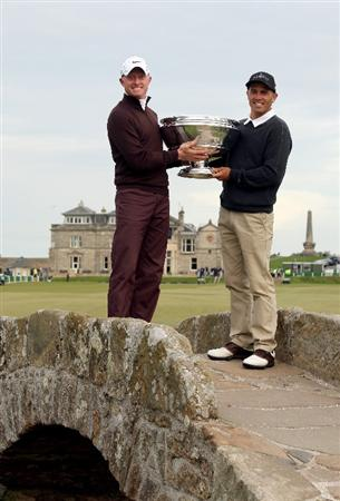 ST ANDREWS, SCOTLAND - OCTOBER 05:  Simon Dyson of England and his playing partner Kelly Sltaer hold the trophy aloft after victory at the The Alfred Dunhill Links Championship at The Old Course on October 5, 2009 in St.Andrews, Scotland.  (Photo by Warren Little/Getty Images)