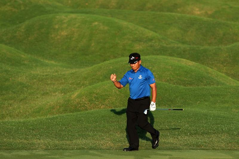 PONTE VEDRA BEACH, FL - MAY 15:  K.J. Choi of South Korea reacts to his chip shot on the 18th hole during the final round of THE PLAYERS Championship held at THE PLAYERS Stadium course at TPC Sawgrass on May 15, 2011 in Ponte Vedra Beach, Florida.  (Photo by Scott Halleran/Getty Images)