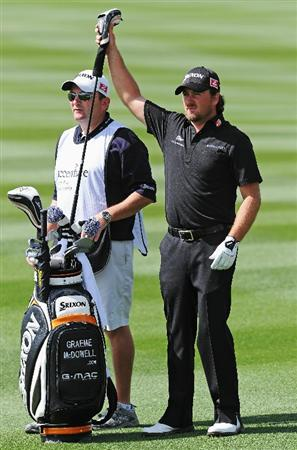 MARANA, AZ - FEBRUARY 24:  Graeme McDowell of Northern Ireland and caddie Ken Comboy on the 13th hole during the second round of the Accenture Match Play Championship at the Ritz-Carlton Golf Club on February 24, 2011 in Marana, Arizona.  (Photo by Stuart Franklin/Getty Images)