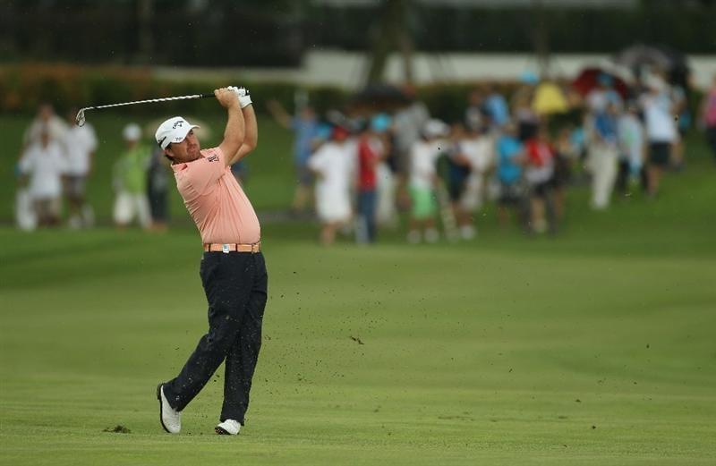 SINGAPORE - NOVEMBER 14:  Graeme McDowell of Northern Ireland in action during the Final Round of the Barclays Singapore Open at Sentosa Golf Club on November 14, 2010 in Singapore, Singapore.  (Photo by Ian Walton/Getty Images)