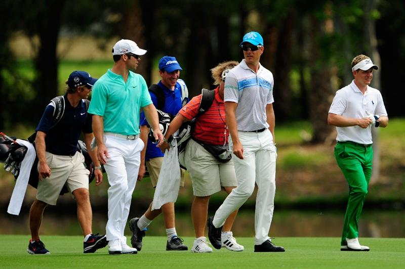 PONTE VEDRA BEACH, FL - MAY 05:  (L-R) Paul Casey of England, Henrik Stenson of Sweden and Luke Donald of England walk with their caddies during a practice round prior to the start of THE PLAYERS Championship held at THE PLAYERS Stadium course at TPC Sawgrass on May 5, 2010 in Ponte Vedra Beach, Florida.  (Photo by Sam Greenwood/Getty Images)