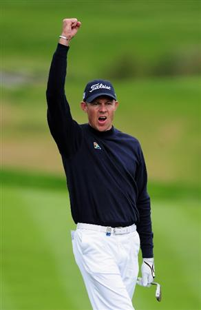 COLOGNE, GERMANY - SEPTEMBER 13:  James Kingston of South Africa celebrates holding his chip on the eighth hole during the final round of The Mercedes-Benz Championship at The Gut Larchenhof Golf Club on September 13, 2009 in Cologne, Germany.  (Photo by Stuart Franklin/Getty Images)