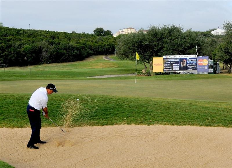 SAN ANTONIO,TX - OCTOBER 10: Olin Browne blasts out of the greenside bunker on the 5th hole  during the second round of the Valero Texas Open  held at La Cantera Golf Club on October 10, 2008 in San Antonio, Texas  (Photo by Marc Feldman\Getty Images)